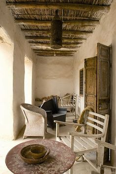 Authenticity of Moroccan Atlas architecture in the outskirts of Marrakech - earth and sandy neutral tones, pisé walls and unplastered ceilings showing wooden beams and reed / Veranda - Jean-Philippe Degoy Mediterranean Houses, Adobe Haus, Outdoor Spaces, Outdoor Living, Interior And Exterior, Interior Design, Global Style, Rustic Interiors, Rustic Style