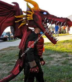 Homemade Dragon Halloween Costume Idea: Beginning materials: PVC pipe, Dense foam, Fabric stuffing, ping pong balls, blue led lights, wood, Air brush paint and various fabrics.  Tools needed: