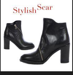 #Stivaletto in #pelle, chiusura con #zip asimmetrica, #tacco in cuoio h 85 mm, suola in gomma. Pratico, deciso e forte: http://bit.ly/1s849TP #heel #style #woman