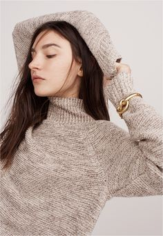 madewell knotted hinge bracelet worn with the raglan turtleneck sweater.