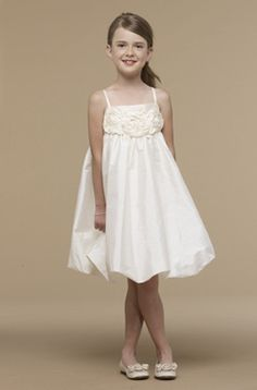Adorable US Angles spaghetti strap bubble hem dress available in Ivory or Pink at September's Bride.