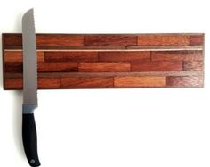 This magnetic knife rack has been designed as a stylish way to store your prized kitchen knives. The surface is made from reclaimed hardwood Magnetic Knife Rack, Kitchen Equipment, Kitchen Pantry, Knife Block, Kitchen Organization, Kitchen Knives, Wall Mount, Hardwood, Cutting Boards