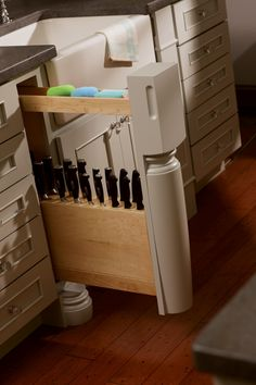 Individual slots in a Dura Supreme pull-out knife block protect blades and keep handles accessible. You can add a decorative post to add character to your kitchen on any thin pull-out cabinet.