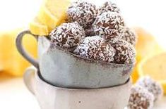 Lemon Coconut Chia Energy Balls - The Healthy Maven Bring together tart lemon with sweet coconut in these nutrition-packed Lemon Coconut Chia Energy Balls. These portable snacks help you curb your hunger when you need that PM pick-me-up! Vegan Dessert Recipes, Lemon Desserts, Snack Recipes, Juicer Recipes, Protein Snacks, Healthy Snacks, Healthy Energy Ball Recipe, Coconut Energy Balls, Yummy Snacks