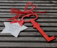 Personalised wooden santa key for Christmas Eve by scratchycat