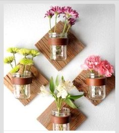 Cut a perfect 1x1 nail into wall hook up some jar vases add ribbon and add fake flowers or real in season flowers