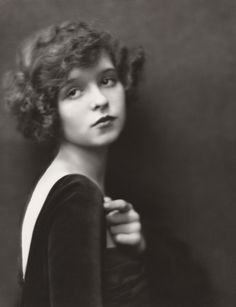 Sixteen-year-old Clara Bow in a dramatic pose photographed by Nickolas Muray circa 1921.