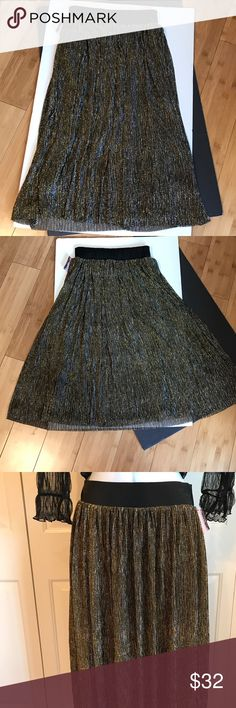 "METALLIC PLEATED BLACK SKIRT Tiny pleats adorn this skirt with gold black and silver. Elastic waistband. XS: Waist 12""-13"" Length 28"". S: Waist 13""-14"" Length 29"". M: Waist 14.5""-16"" Length 29"". This is Gorgeous pictures don't do it justice to your next semi formal event. -No trades Xhilaration Skirts Midi"