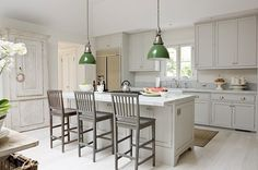 Fresh paint and stylish handles dress up simple cabinets.