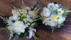 Bridal hand tied bouquet and bridesmaids posy of white peonies, cream roses, pale blue hydrangea, daisies and pretty white Astilbe.