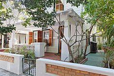 Classic Key West bungalow porch | Key West Porches & Gingerbread...shutters