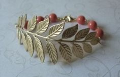 I don't usually like bracelets, but I would wear this one.  Golden Brass Branch and Coral Pearl Bracelet from vintageandglam's etsy shop