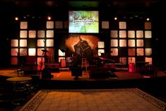 """Van Metschke at South Hills Church in Corona, California loosely based this design on a stage he saw at Mariners church in Irvine, CA. The """"App Wall"""" as it was dubbed, is made up of multiple x squares of Luan Church Backgrounds, Church Stage Design, Modern Church, Stage Set, Center Stage, Stage Lighting, Staging, Design Ideas, Ideas"""