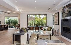 A spacious and open floor plan makes this living space flow freely into the the kitchen and outdoor space that also features a pool. 6242 Drexel Ave | Beverly Grove
