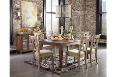"""The Mestler Dining Table from Ashley Furniture HomeStore (AFHS.com). With the variety of finishes beautifully adorning the rich rustic design of each piece, the """"Mestler"""" dining collection takes Vintage Casual and offers an array of furniture to suit the needs of any dining room décor."""