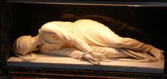 Church of Santa Cecilia in Trastevere   In the sculpture, St. Cecilia extends three fingers with her right hand and one with her left, testifiying to the Trinity, three persons in one God.  The sculptor attested that this was how her body looked when her tomb was opened in 1599