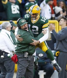 Green Bay Packers quarterback Aaron Rodgers leaps into the arms of coach Mike McCarthy after throwing a touchdown against the Arizona Cardinals during the first half of an NFL football game Sunday, Nov. in Green Bay, Wis. (AP Photo/Tom Lynn) i-packers Packers Baby, Go Packers, Packers Football, Best Football Team, National Football League, Football Season, Greenbay Packers, Packers Funny, Football Memes