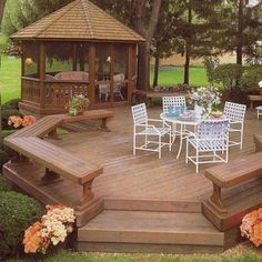 Open, freestanding deck with bench seating plus a screened gazebo with screen doors to escape to when the mosquitoes come out. this is what i would love in the back yard.