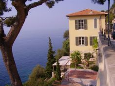One of these days I will run away to this farm house on the coast of Italy.