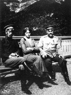 Nicholas, daughter Olga, and Dr. Botkin in 1914, the year the end began.  Botkin, the court physician, went into exile with the family and was murdered along with them by the Bolsheviks in 1918.