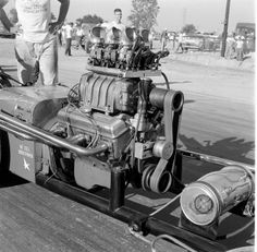 '59 NHRA Nationals in Detroit, a small block slingshot topped with a 4-71 with six 97's