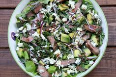Recipe for steak salad with blue cheese, avocado and basil balsamic dressing, made with grilled or seared beef, avocado, blue cheese, and red onions.