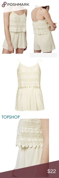 """TopShop Crochet Layered Romper A popover-style bodice of scalloped crochet lace adds a sweet touch to a sun-loving romper cut from crinkled cotton with flouncy, flared legs. - 21"""" center front length; 2"""" inseam; 31"""" leg opening (size 8) - Non-adjustable tie straps - V-neck - Sleeveless - 100% cotton - Dry clean or machine wash cold, line dry Size 8 Cream Topshop Tops"""