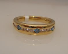 14 karat yellow gold gents ring with white and blue diamond band, stylish and unique!  $639