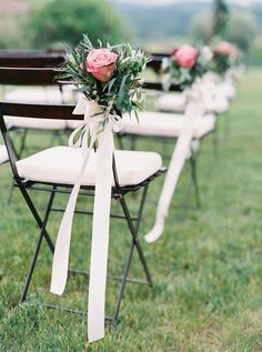Floral and ribbon accented wedding ceremony chairs: http://www.stylemepretty.com/collection/3684/