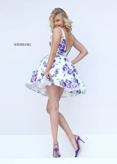 This fun flower printed Sherri Hill 50369 prom dress is perfect for day or evening events. Its scooped neckline gives way to comfortably wide straps that embrace the shoulders. The bodice is fitted to the natural waistline, with gathering atop the attached skirt. Its full A-line skirt is nice and full with a ruffled crinoline underneath adding extra volume. The backline plunges in a V to bring the look to completion.
