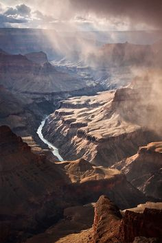 Deep depth of field Colors - very natural, browns and blues Asymmetrically balanced, there seems to be even weight on both sides Movement created especially through the river. The many layers of the canyon also bring the viewer's eyes through the piece, from bottom to top
