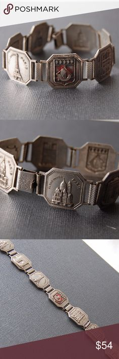 """Vintage 1930-40s Souvenir Bracelet from Paris This fabulous vintage 1930-40s French Souvenir Bracelet from Paris is a wonderful gift for any francophile. It's in excellent condition, save for some enamel that has been worn off of the center shield link, leaving a hint of red. Monuments featured are Sacre Coeur, Arc de Triomphe, Tour Eiffel, Shield of Paris, Notre Dame, Opera, and Invalides. Each link measures .75"""" square with a total length of 8"""". Even the link connectors and push clasp…"""