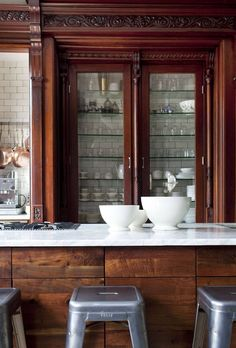 How elegant are the details on the original wood trim and cabinetry in this old kitchen? The modern industrial bar stools are the perfect accents to balance out the space! Kitchen Cabinet Design, Kitchen Interior, New Kitchen, Kitchen Dining, Kitchen Decor, Kitchen Cabinets, Kitchen Cupboard, Kitchen Storage, Kitchen Benchtops