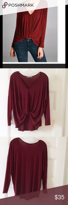 Burgundy knot front top NWOT Boutique brand burgundy knot front top, drop shoulder/dolman fit, V neck, fabric and measurements pictured. Adorable, just doesn't flatter me, so am rePoshing. Cherish Tops