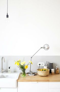 Wood counter top and painted wall instead of backsplash - Apartment Therapy: Partial Paint Jobs: 5 Ways to Pull It Off