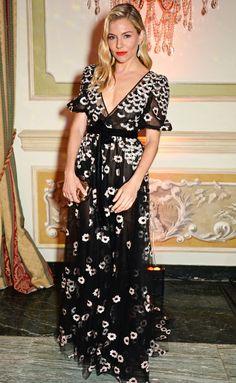 Sienna Miller in a black patterned dress
