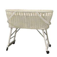 Leche Bassinet || Vintage baby bassinet in white wicker on wheels. Dimensions: 33 x 20 x 28.