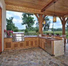 beautiful outdoor kitchen=add a stove top and you could make it a canning kitchen too.