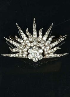A Victorian diamond rising sun royal presentation brooch, circa 1895. This brooch was given as a wedding present to Lady Eva Greville from the Duke and Duchess of York at her marriage to Mr Frank Dugdale. Lady Eva, daughter of the Earl of Warwick and Lady-in-waiting to the Duchess of York, was married at St Margaret's Church, Westminster in 1895. It was illustrated, along with other presentation jewels, in 'The Queen, The Lady's Newspaper' #Victorian #RoyalPresentation #brooch