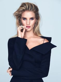 Rosie Huntington-Whiteley shows some shoulder in Dior jacket and skirt
