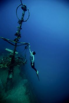 Guillaume playing in a wreck in New Caledonia.