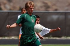 Kelly Walsh's Seth Romsa, left, fights to keep the ball away from Rock Springs' Edgar Arana during the consolation finals of the Wyoming State High School Class 4A Boys Soccer Championship. The story is at http://trib.com/sports/high-school/soccer-girls/