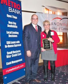 Dave Tyndall, from Metro Bank and Chair of the Chamber's Ambassadors Committee, presents Ambassador of the Year award to Ann Decker, busines...