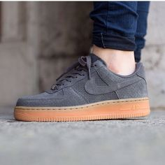 Nike Grey Air Force 1 Sneakers Never worn Nike Air Force 1 Sneakers in grey suede. Normally I'm a size 7 but these felt about a size too big on me.  That's why I'm selling.  IMPORTANT: these are actually a 7, but they fit more like a 7.5-8 which is why I listed them as 7.5 Nike Shoes Sneakers