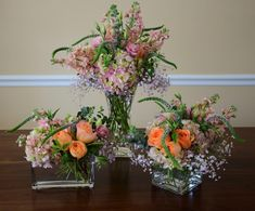Trio of flower arrangement to decorate home with snap dragons, hydrangeas, roses, veronica, baby breath.