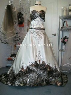 Camo wedding dress!:) SHOULD BE BRITS DRESS WITH THE WAY ANDREW LOVES CAMO !! LOL