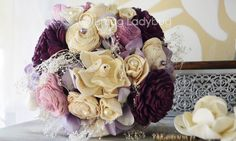 Cascading purple sola bouquet with dried baby's breath and pearl accents.