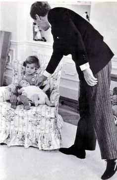 "jfk-and-jackie: "" President Kennedy photographed by Mark Shaw in the White House Nursery, The President, dressed to make a speech, stopped to play with John-John. Maud Shaw, the proud. Caroline Kennedy, Jacqueline Kennedy Onassis, John Kennedy Jr., Les Kennedy, Jaqueline Kennedy, Carolyn Bessette Kennedy, Sweet Caroline, American Presidents, American History"