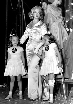 Fred Morgan - Marilyn Monroe - January 28 1958 - with March of Dimes poster children, Linda Lou and Sandy Sue, at the 14th Annual March of Dimes Fashion Show at the Waldorf Astoria