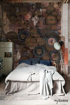 "I love this room for some reason. I don't really like the gears, but I like the simplicity of the bed, the tall lamp, and ""blank"" wall space (even though it's not really blank... just use your imagination). I also like the tall ceilings and the sunlight."